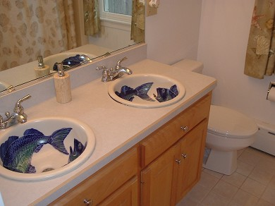 Chatham Cape Cod vacation rental - A full bathroom with hand painted sinks from Chatham Pottery