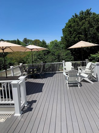Harwich Cape Cod vacation rental - Sunny 30x20 back Azek deck with 3 seating sections.