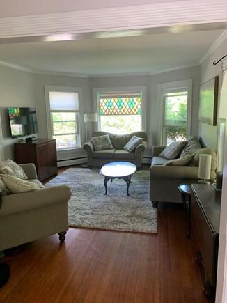 Harwich Cape Cod vacation rental - Living room with flatscreen smart TV, hardwood floors.