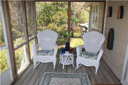 East Orleans Cape Cod vacation rental - Screened-in porch, A Guest Favorite- 4 Wicker Rockers, 2 Tables)