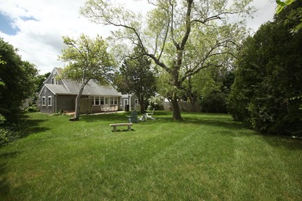 Hyannis Cape Cod vacation rental - Backyard is large & shady. Grill & dine al fresco! Outdoor shower