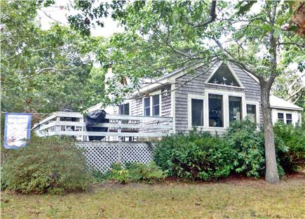North Eastham - Bayside Cape Cod vacation rental - Enjoy the 2 deck areas on this large yard near the beach!
