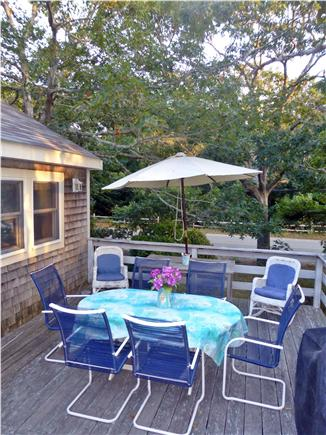 North Eastham - Bayside Cape Cod vacation rental - Front deck dining area and barbecue