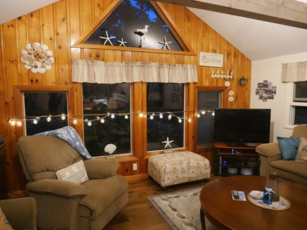 North Eastham - Bayside Cape Cod vacation rental - Living area with open beam ceilings