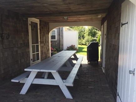 West Dennis Cape Cod vacation rental - Picnic tables and gas grill in breezeway
