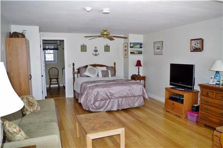Dennis Port Cape Cod vacation rental - Combined living and sleeping area (kitchen through far doorway)