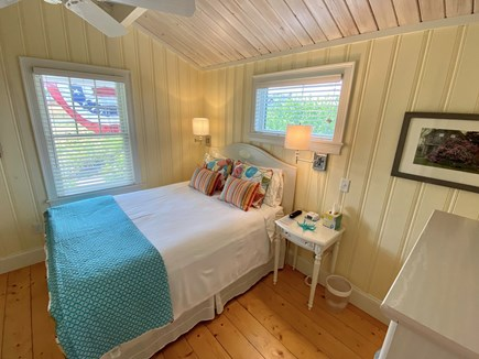 Wellfleet Harbor Cape Cod vacation rental - Queen bedroom with flatscreen TV and cathedral ceiling.