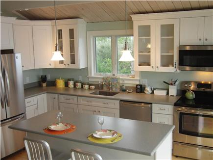 Wellfleet Harbor Cape Cod vacation rental - The Chef's Kitchen Features Hardwood Cabinets & Corian