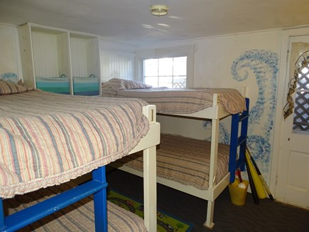 Falmouth Cape Cod vacation rental - First floor bunk bed room with toys and TV, sleeps 4