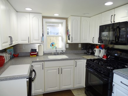 Falmouth Cape Cod vacation rental - Kitchen area with door to grilling area