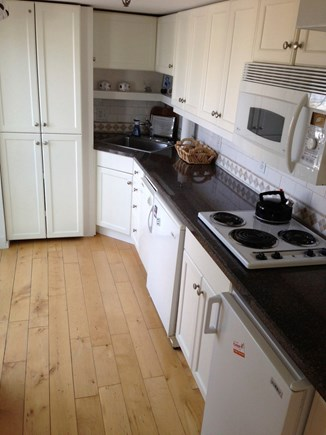 Provincetown Cape Cod vacation rental - Galley kitchen, washer/dryer with balcony overlooking street!