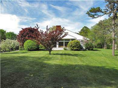 Harwich Port Cape Cod vacation rental - Sunroom and large side lawn - perfect for family sports!
