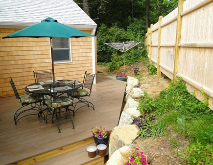 Wellfleet Cape Cod vacation rental - Private deck with grill, flowers, outdoor shower beyond