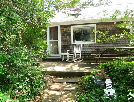 Wellfleet Cape Cod vacation rental - Front of house with patio – Adirondacks and picnic table