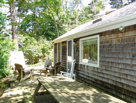 Wellfleet Cape Cod vacation rental - Front area with Adirondack chairs and picnic table