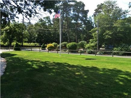 West Harwich Cape Cod vacation rental - Front Yard with Flag Pole and Vineyard View
