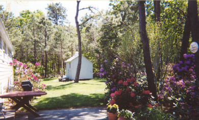 Dennis Cape Cod vacation rental - Patio with outdoor dining and lovely landscaping