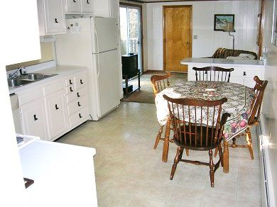 Dennis Cape Cod vacation rental - Freshly Painted Kitchen opens to Den w/ slider to Patio Garden