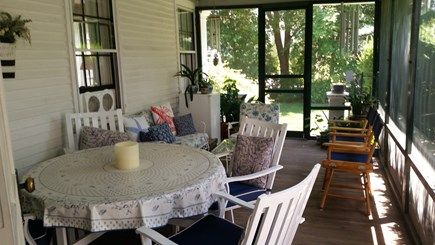 Cotuit Cotuit vacation rental - Screened porch has table for 6 and extra tables for 4 and 8..