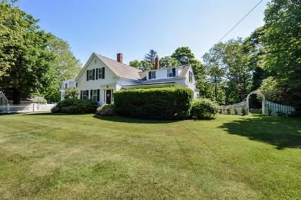 Cotuit Cotuit vacation rental - Front yard. Arbor leads to gardens and back yard.