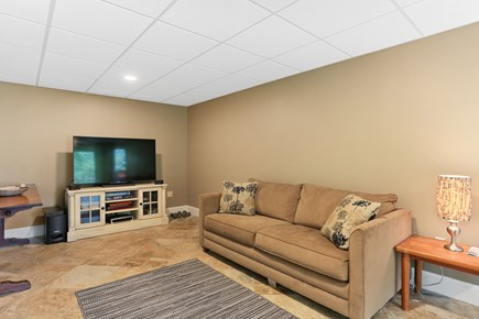 Chatham Cape Cod vacation rental - Spacious lower level media room with sleep sofa, walkout to patio