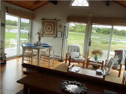 Wellfleet Harbor & Beach Cape Cod vacation rental - Part of the Living Room/Dining Room area. Surrounded by beauty.
