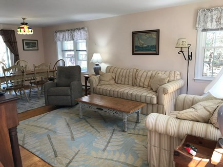 Eastham Cape Cod vacation rental - Living and dining area open through sliders to the deck