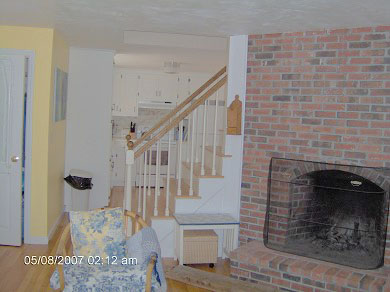 Dennis Cape Cod vacation rental - Fireplaced living room - the stairs lead to 2 bedrooms and bath