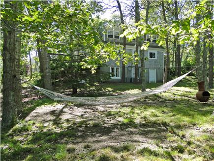 So. Harwich/So. Chatham Cape Cod vacation rental - Relax in the spacious 1/2-acre back yard with cozy stone fire pit