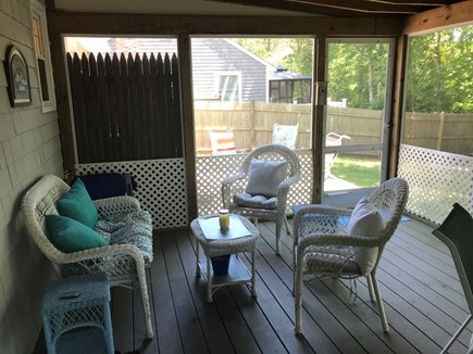 West Yarmouth Cape Cod vacation rental - Shady and cool porch with two seating areas
