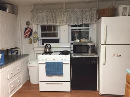 Harwich Port Cape Cod vacation rental - Spacious kitchen with new floor and 1/2 bath on side.