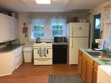 Harwich Port Cape Cod vacation rental - Spacious kitchen with 1/2 bath on side.