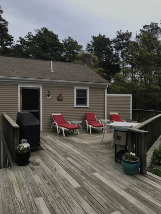 Eastham Cape Cod vacation rental - Oversized deck view to studio & outside shower. 2 patio tables-12