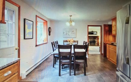 Eastham Cape Cod vacation rental - Dining area has rom for 12 with leaves in the table.
