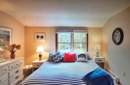 Eastham Cape Cod vacation rental - Kingsize bed in upstairs bedroom with nautical blue theme.