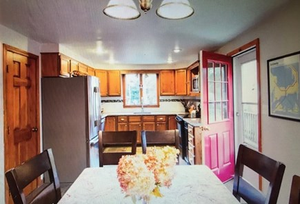 Eastham Cape Cod vacation rental - Kitchen with large dining table & chairs for 12.