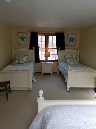 West Harwich Cape Cod vacation rental - 2nd upstairs bedroom with three twins (one not shown)