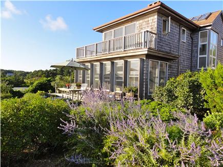 Wellfleet Harbor, on the Bluff Cape Cod vacation rental - Front of house with both decks and walls of glass, facing water