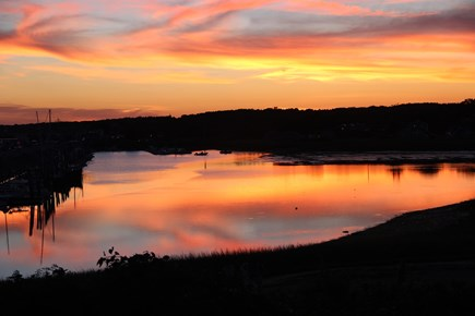 Wellfleet Harbor, on the Bluff Cape Cod vacation rental - Glorious Sunset from the top deck looking toward town and pier.