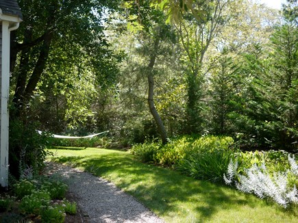 Wellfleet Cape Cod vacation rental - Right side of the house and view into the gardens and hammock.