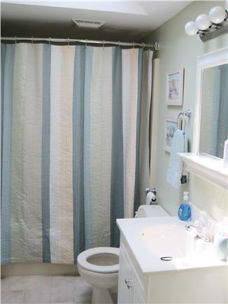Falmouth Cape Cod vacation rental - Second-floor bathroom with rain showerhead and skylight