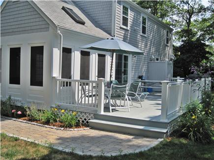 Falmouth Cape Cod vacation rental - Deck with outdoor shower, gas grill & 10-person picnic table