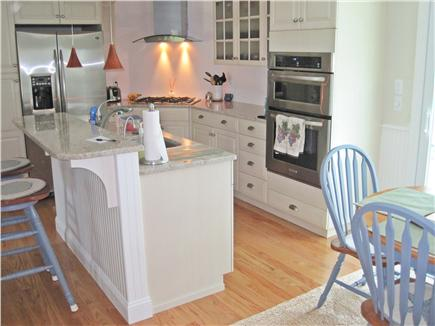 Falmouth Cape Cod vacation rental - Center island kitchen with second refrigerator in basement