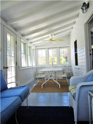 Harwich Port Cape Cod vacation rental - Enclosed Porch w/table for 6 and TV, couch and 3 wicker chairs
