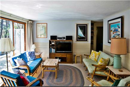 North Eastham Cape Cod vacation rental - Living room (two 8 foot sliders overlook pine grove)