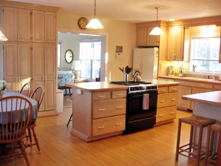 South Yarmouth Cape Cod vacation rental - Main entrance door with table for 8 surrounded by windows