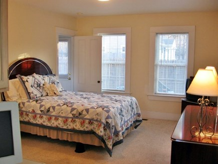 South Yarmouth Cape Cod vacation rental - Sitting at built in desk/shelves area looking at back patio.