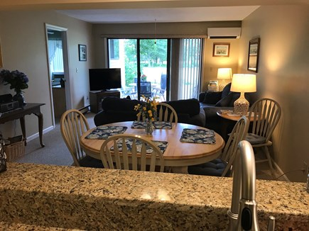Brewster Cape Cod vacation rental - Dining room/living room with slider to patio.