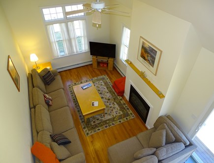 Eastham Cape Cod vacation rental - Living room with fireplace and flat screen TV, view from loft