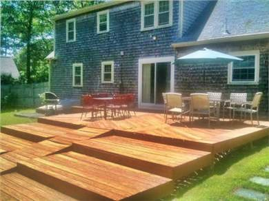 Falmouth Cape Cod vacation rental - Tiered deck overlooking pool. Tables, chairs, gas grill.